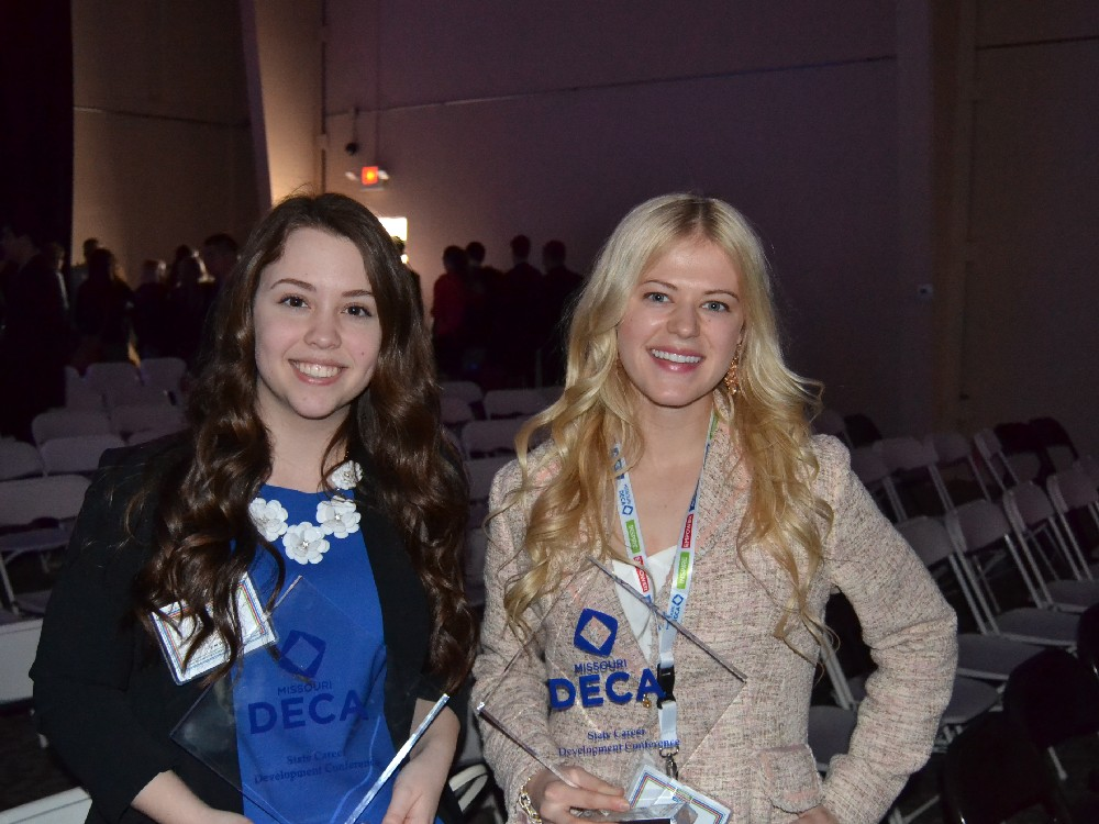 DECA_emily and lilly w trophies